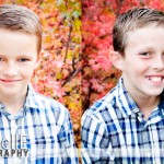 boys portraits with fall leaves in background
