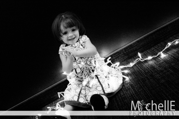 girl in christmas lights in black and white, christmas card
